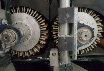 Butfering Machine Rollers with Unosand Slip System Brushes.